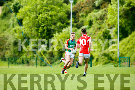 In Action M. Kerry's Donnachadh Walsh and E.Kerry's Paudie Clifford  at the  Garveys Supervalu Senior County Football Championship Round 2B East Kerry V Mid Kerry at Dr Crokes Lewis Road Killarney on Sunday