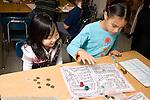 Education Elementary School New York Grade 3 mathematics children playing homemade game horizontal two girls playing