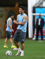 Luis Suarez of Uruguay rubs his hands together and smiles as he trains in the Arena Corinthians, Sao Paulo ahead of his sides Group D crunch fixture vs England tomorrow