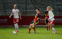20161128 - TUBIZE ,  BELGIUM : Belgian Elien Van Wynendaele (M) with Danish Sanne Troelsgaard (L) and Pernille Harder (R)  pictured during the female soccer game between the Belgian Red Flames and Denmark , a friendly game before the European Championship in The Netherlands 2017  , Monday 28 th November 2016 at Stade Leburton in Tubize , Belgium. PHOTO SPORTPIX.BE | DIRK VUYLSTEKE