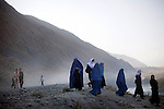 Girls walk to a school located between two villages in remote Baharak district, Badakhshan province, Afghanistan, Saturday morning, Oct. 24, 2009. The school has 300 students and 13 teachers, some of whom walk two hours each way to school every day. Ninth-grade girls occupy two of the school's classrooms. As the Obama Administration seeks the formula for turning the tide of the war in Afghanistan, some aid organizations are advocating the National Solidarity Programme, a community-based development program that has made progress in some districts, setting up local councils that propose much-needed projects such as schools, drinking water facilities and roads.
