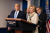 United States President Donald J. Trump, left, listens as Dr. Deborah L. Birx, White House Coronavirus Response Coordinator, right center, speaks during a news briefing by members of the Coronavirus Task Force at the White House in Washington, DC on Monday, March 23, 2020.  At left center is US Vice President Mike Pence and at right is US Attorney General William P. Barr.<br /> Credit: Chris Kleponis / Pool via CNP/AdMedia