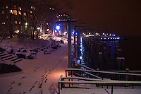 Snow covered path alongside wooden piles  in the river. Images of New York 2005, New York,U.S.A