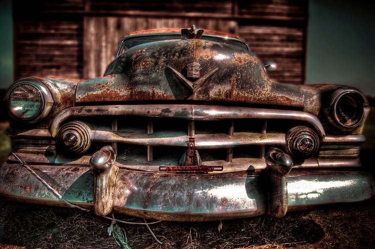 A 1950's American Cadilac car with rust and chrome bumper