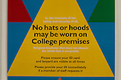 Sign informing students that no hats or hoodies may be worn on college premises, Kingston College of Further Education, Surrey