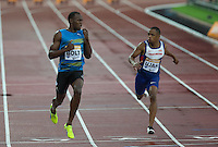 Usain BOLT of Jamaica (Men's 100m) finishes heat 2 in a time of 9.87 with 4th placed Chijindu UJAH of GBR (Men's 100m) running 10.04 during the Sainsburys Anniversary Games at the Olympic Park, London, England on 24 July 2015. Photo by Andy Rowland.