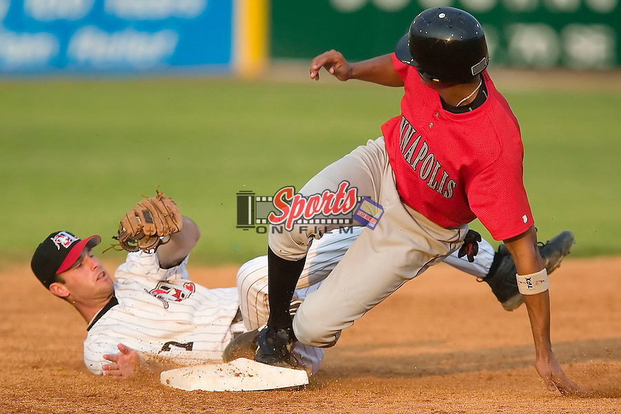 Hickory second baseman Shelby Ford holds on to the ball after tagging out Kannapolis outfielder Salvador Sanchez in game action at L.P. Frans Stadium in Hickory, NC, Thursday, June 29, 2006.