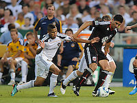 DC United forward Pablo Hernadez (21) shields the ball against LA Galaxy midfielder Sean Franklin (23). LA Galaxy defeated DC United 2-1 at RFK Stadium, Saturday July 18, 2010.