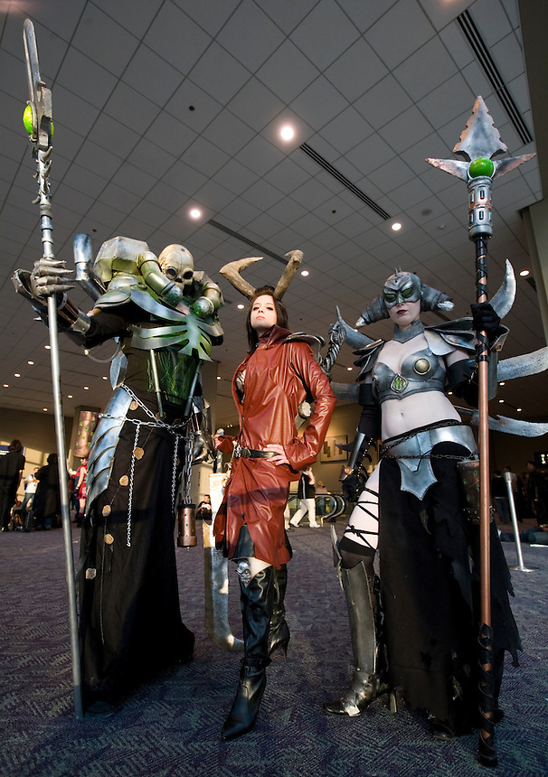 Photo by Stephen Brashear.Privateer Press Warmachine fans, from left, Tosha Stephens, dressed up as Skarre, Jarnigan Cook, dressed up as Asphyxious and Ashley Cooks dress up as Deneghra pose of photos on the second day of the Penny Arcade Exposition at the Washington State Visitor and Convention Center in Seattle, Wash., Saturday Aug. 29, 2008. The trio, from Eugene, Ore. where the Cooks own a game store, spent several hours getting into their costumes, which included chainmail in Stephen's costume.