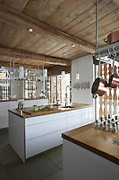 In the heart of the high Engadin, the kitchen of a 14th century chalet has been restored in a clean and contemporary style