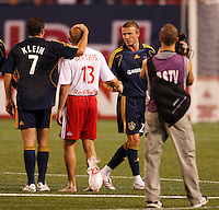 Los Angeles Galaxy midfielder (23) David Beckham shakes hands with New York Red Bulls midfielder (13) Clint Mathis after the end of an MLS regular season match at Giants Stadium, East Rutherford, NJ, on August 18, 2007. The Red Bulls defeated the Galaxy 5-4.