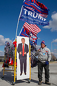 A salesman brings his merchandise to sell to rally goers prior to at which United States President Donald J. Trump will speak in Moon Township, Pennsylvania on March 10, 2018. Credit: Alex Edelman / CNP