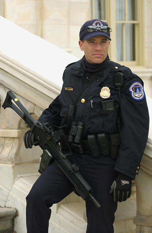 3/19/03.U.S. CAPITOL SECURITY--A member of the U.S. Capitol Police, holding an automatic weapon, stands guard on the West Front of the U.S. Capitol..CONGRESSIONAL QUARTERLY PHOTO BY SCOTT J. FERRELL