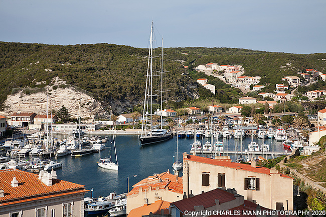 The large yacht Twizzle dominates the harbor at Bonifacio, towering over all other boats.