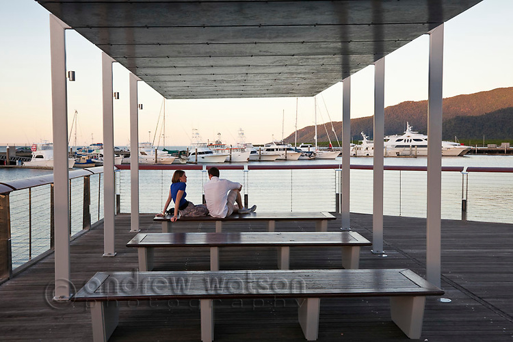 Couple relaxing at Marina Point.  Cairns, Queensland, Australia