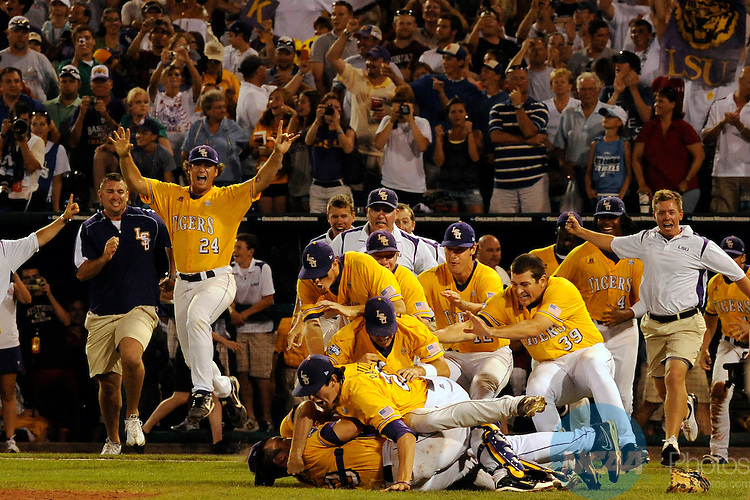 24 JUNE 2009:  Louisiana State University celebrates their victory over the University of Texas during the Division I Men's Baseball Championship held at Rosenblatt Stadium in Omaha, NE.  LSU defeated Texas 11-4 for the national title.  Chris Steppig/NCAA Photos