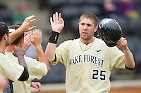 Matt Conway (25) celebrates after scoring a run against the Virginia Cavaliers at Wake Forest Baseball Park on May 17, 2014 in Winston-Salem, North Carolina.  The Demon Deacons defeated the Cavaliers 4-3.  (Brian Westerholt/Four Seam Images)