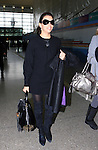 AbilityFilms@yahoo.com 805-427-3519.www.AbilityFilms.com.1-22-08 Eva Longoria at the L.A.X airport in Los Angeles flying somewhere with a coat and luggage
