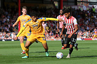 Ollie Watkins of Brentford takes on Reece James of Wigan Athletic during Brentford vs Wigan Athletic, Sky Bet EFL Championship Football at Griffin Park on 15th September 2018