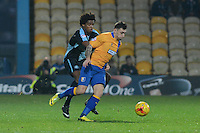 Wycombe Wanderers Sido Jombati puts Mansfield Town's Nathan Thomas under pressure during the Sky Bet League 2 match between Mansfield Town and Wycombe Wanderers at the One Call Stadium, Mansfield, England on 31 October 2015. Photo by Garry Griffiths.