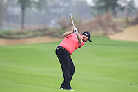 Shane Lowry (IRL) plays his 2nd shot on the 10th hole during Friday's Round 2 of the 2014 BMW Masters held at Lake Malaren, Shanghai, China 31st October 2014.<br /> Picture: Eoin Clarke www.golffile.ie