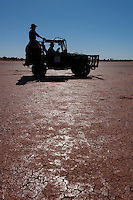 Camel catchers in toyota on desert claypan,  Central Australia, Northern Territory, Australia.