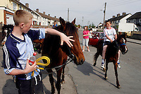 Youths pictured riding their ponies on a sunny day in the suburb of Finglas, Dublin, Ireland.<br /> Picture James Horan