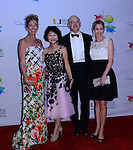 MIAMI, FL - FEBRUARY 13: Jamie Rusk, Geogia Nimer, Dr. Stephen Nimer, and Denie Harris arrive to the Oscar De La Renta fashion show during the Designed For A Cure 2014 Benefiting Sylvester Comprehensive Cancer Center at Ice Palace on February 13, 2014 in Miami, Florida. (Photo by Johnny Louis/jlnphotography.com)