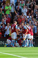 Saturday 15 September 2012<br /> Pictured: Matthew Lowton of Aston Villa mobbed by team mates celebrating his opening goal.<br /> Re: Barclay's Premier League, Aston Villa v Swansea City FC at Villa Park, West Midlands, UK.