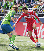 Seattle Sounders FC forward Marco Pappa tries to get past Seattle Sounders FC midfielder Erik Friberg  during play at Qwest Field in Seattle Tuesday April 8, 2011. The Sounders won the game 2-1.