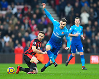 Marc Pugh of AFC Bournemouth left makes a tackle on Aaron Ramsey of Arsenal during AFC Bournemouth vs Arsenal, Premier League Football at the Vitality Stadium on 14th January 2018