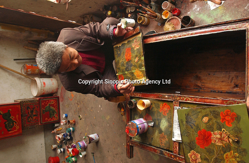 Workers make antique style furniture at a small factorty in Beijing, China..23-NOV-03