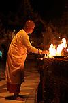 Monk Light candles in The Shwedagon Paya at night