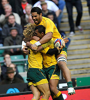 Twickenham, England. Nick Cummins of Australia mobed after his try during the QBE international match between England and Australia for the Cook Cup at Twickenham Stadium on November 10, 2012 in Twickenham, England