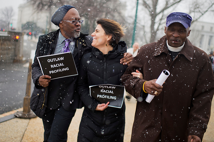 "UNITED STATES - JANUARY 21: Allison Mickelson of New York, center, Rev. Dr. T. Anthony Spearman, right, of North Carolina, and another protester representing the Black Lives Matter movement, march to the Capitol after a ""die in"" in the Longworth cafeteria to call on Congress to take action on racial issues, January 21, 2015. (Photo By Tom Williams/CQ Roll Call)"