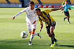 Brisbane Roar's Dimitri Petratos, left and Phoenix's Manny Muscat, right, chase the ball in the A-League football match at Westpac Stadium, Wellington, New Zealand, Sunday, January 04, 2015. Credit: Dean Pemberton