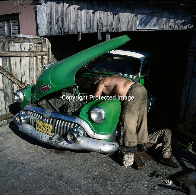 A man repairs an old Buick car in Matanza, Cuba. The country had a severe drop in economic growth since the expiration of aid from the former Soviet Union after the end of communism. Fidel Castro has ruled the communist island for over four decades, and been in war of words with the United States all since then. They country has a good education and medical level but lacks a free press and freedom of speech.