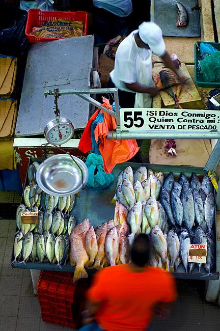 Fish vendor prepares fresh fish for a customer in his stall at the Fish Market (El Mercado del<br /> Marisco) in the Casco Viejo neighborhood of Panama City, Panama.