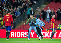 A pitch invader looks for a photo with Alvaro Morata of Spain during the International Friendly match between England and Spain at Wembley Stadium, London, England on 15 November 2016. Photo by Andy Rowland.