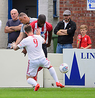 Lincoln City's John Akinde vies for possession with Lincoln United's Danny North<br /> <br /> Photographer Chris Vaughan/CameraSport<br /> <br /> Football Pre-Season Friendly (Community Festival of Lincolnshire) - Lincoln City v Lincoln United - Saturday 6th July 2019 - The Martin & Co Arena - Gainsborough<br /> <br /> World Copyright © 2018 CameraSport. All rights reserved. 43 Linden Ave. Countesthorpe. Leicester. England. LE8 5PG - Tel: +44 (0) 116 277 4147 - admin@camerasport.com - www.camerasport.com
