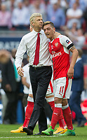 Arsenal Manager Arsene Wenger hugs Mesut Ozil of Arsenal on the final whistle during the FA Cup FINAL match between Chelsea and Arsenal at Wembley Stadium, London, England on 27 May 2017. Photo by Andy Rowland.