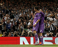 Calcio, Champions League: finale Juventus vs Real Madrid. Cardiff, Millennium Stadium, 3 giugno 2017.<br /> Real Madrid's Cristiano Ronaldo, left, celebrates with his teammate Dani Carvajal after scoring during the Champions League final match between Juventus and Real Madrid at Cardiff's Millennium Stadium, Wales, June 3, 2017. <br /> UPDATE IMAGES PRESS/Isabella Bonotto