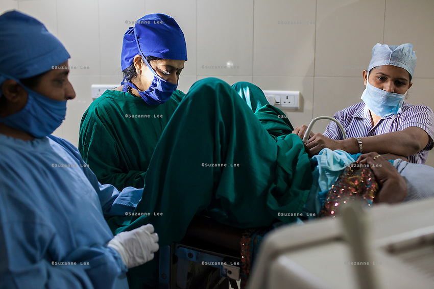 Dr. Nayana Patel performs an embryo transfer on a surrogate in the Akanksha Infertility Center in Anand, Gujarat, India on 12th December 2012.  Photo by Suzanne Lee / Marie-Claire France