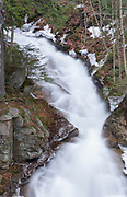 Franconia Notch State Park - Liberty Gorge Cascade during the spring months in Lincoln, New Hampshire USA. This waterfall is located in the Flume Gorge Scenic Area along Cascade Brook.