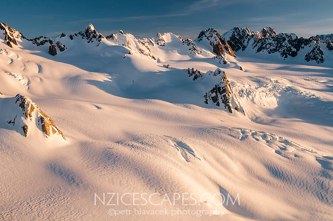Sunset over Main Divide and Chamberlin Snowfield of Franz Josef Glacier, Westland National Park, West Coast, Westland Tai Poutini National Park, World Heritage Area, New Zealand