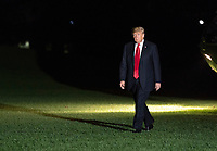 United States President Donald J. Trump walks across the South Lawn as he returns to The White House in Washington, DC after attending political events in Erie, Pennsylvania on Wednesday, October 10, 2018.<br /> Credit: Chris Kleponis / Pool via CNP /MediaPunch