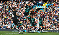 Leeds United's Patrick Bamford competes in the air with Swansea City's Mike van der Hoorn<br /> <br /> Photographer Alex Dodd/CameraSport<br /> <br /> The EFL Sky Bet Championship - Leeds United v Swansea City - Saturday 31st August 2019 - Elland Road - Leeds<br /> <br /> World Copyright © 2019 CameraSport. All rights reserved. 43 Linden Ave. Countesthorpe. Leicester. England. LE8 5PG - Tel: +44 (0) 116 277 4147 - admin@camerasport.com - www.camerasport.com