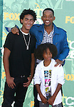 Actor Will Smith (C) and sons Trey Smith and Jaden Smith arrive at the 2008 Teen Choice Awards at the Gibson Amphitheater on August 3, 2008 in Universal City, California.