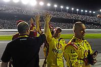 "A. J. Allmendinger's (#22) crew ""high-fives"" before the start of the race."