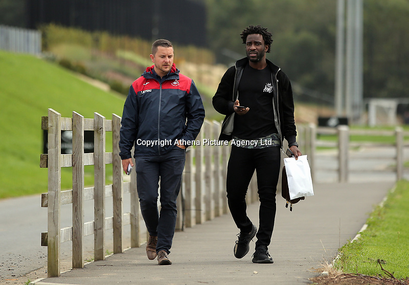 Wilfried Bony (R) arrives with press officer Chris Barney prior to the Swansea City Press Conference at The Fairwood Training Ground, Swansea, Wales, UK. Thursday 07 September 2017